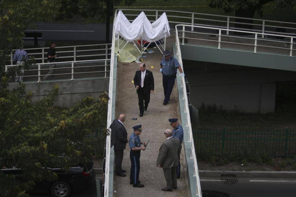 Boston, MA - 6/19/2015: Cops investigate the scene where a man was shot by police on top of a walkway in Boston, MA on June 16, 2015. (Harrison Hill for The Boston Globe)